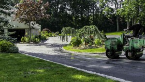 Blacktop Driveway Construction Asphalt Compaction in Center Moriches, New York.