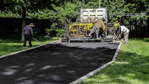 Blacktop Driveway Construction Asphalt Install in Centereach, New York.