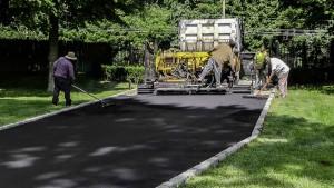 Blacktop Driveway Construction Asphalt Install in Centereach, New York.