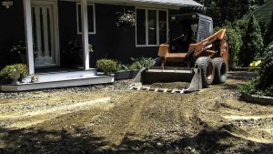 Blacktop Driveway Construction Re-grade in Blue Point, New York.