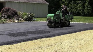 Blacktop Driveway Extension Asphalt Compaction in Lloyd Harbor, New York.