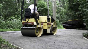 Blacktop Driveway Extension Base Install and Compaction in East Northport, New York.