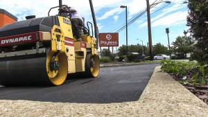 Compacting asphalt of new parking lot in Farmingville New York