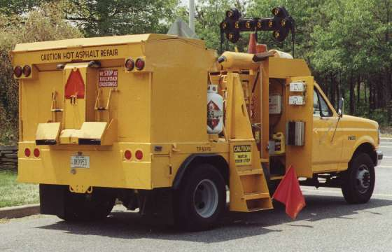 Utility Site Work Trench Repair, Hot Asphalt Repair Vehicle in Kings Park New York.