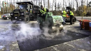 Hot Asphalt Parking Lot Repair in Islip Terrace New York, asphalt compaction stage.