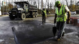Hot Asphalt Parking Lot Repair in Oakdale New York, Connect old and new pavement stage.